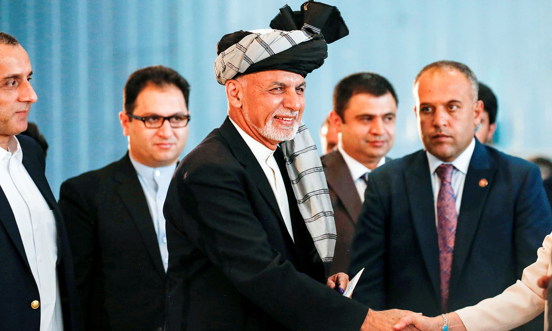 Afghan presidential candidate Ashraf Ghani arrives to cast his vote in the presidential election in Kabul. — Reuters