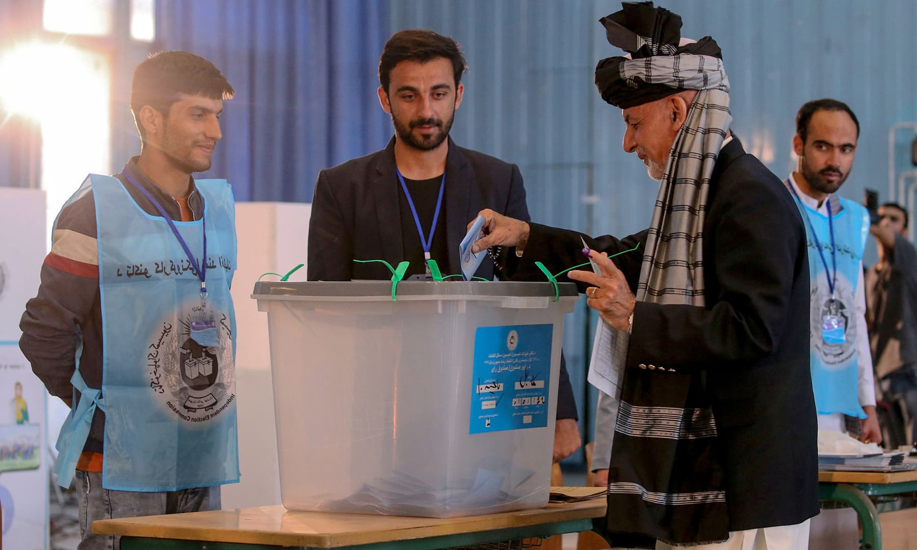 In this handout photograph taken and released by Press Office of President of Afghanistan, Afghan President and candidate Ashraf Ghani casts his vote at a polling station in Kabul. — AFP