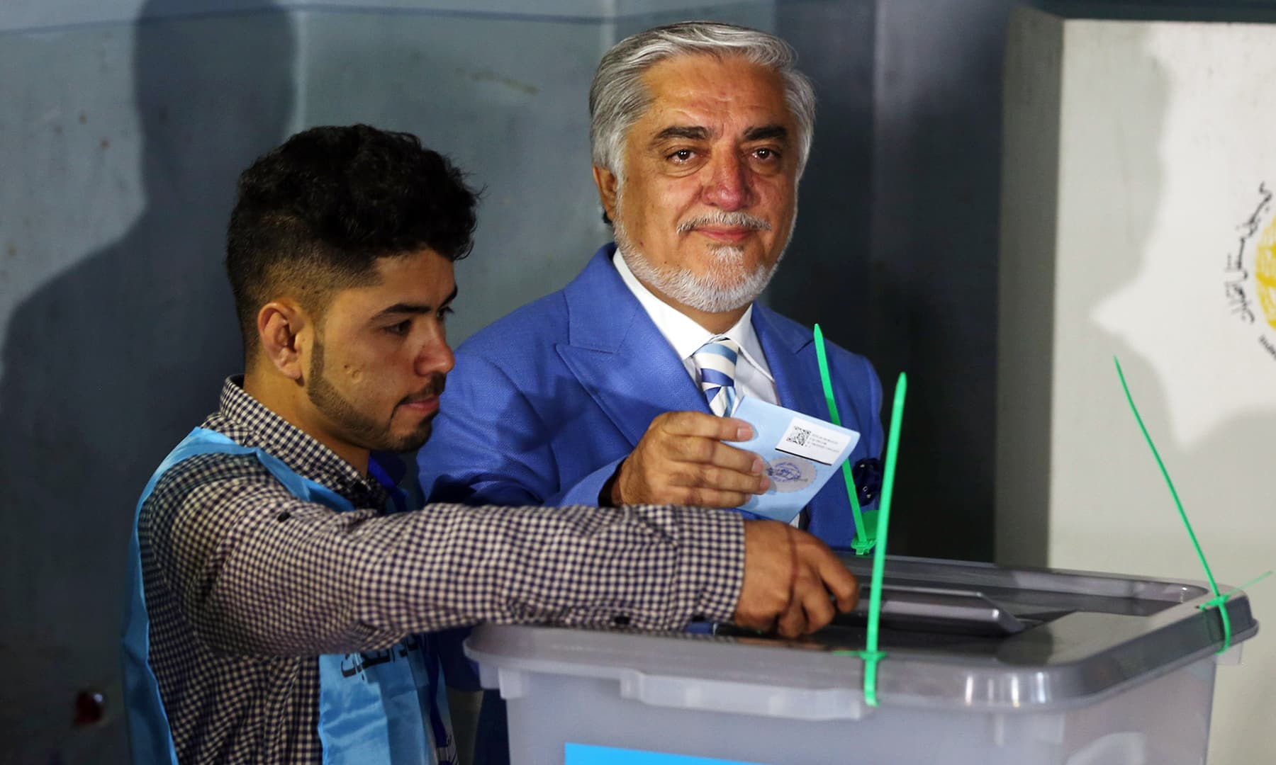 Afghan presidential candidate Abdullah Abdullah casts his vote at a polling station in Kabul. — Reuters
