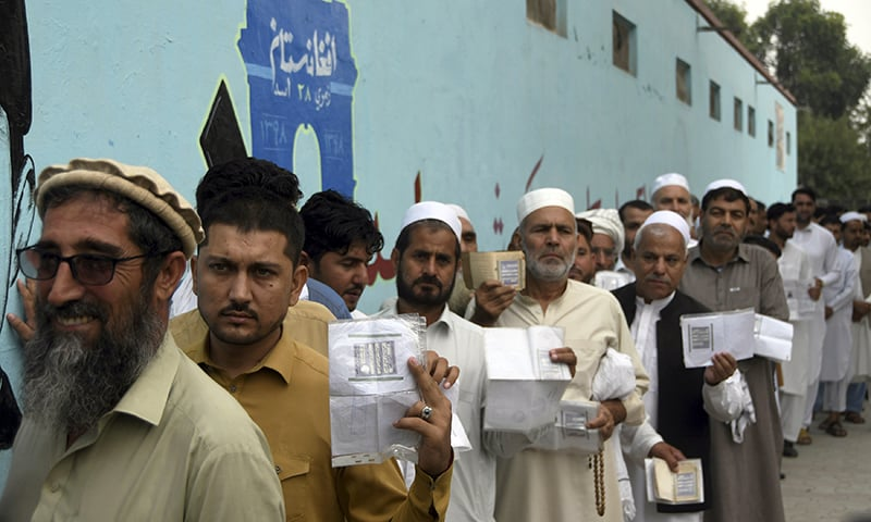 In pictures: Afghan voters brave threat of violence to choose country's president
