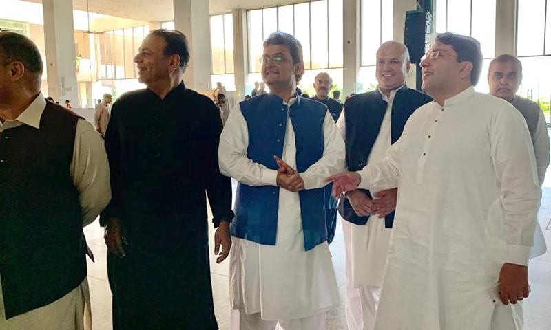 PTI leaders, including chief organiser Saifullah Nyazee and Senator Faisal Javed, waiting at Islamabad airport on Sunday to welcome the prime minister. — DawnNewsTV
