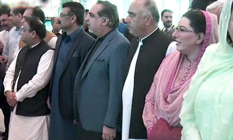 PTI leaders wait at Islamabad airport on Sunday to welcome the prime minister. — DawnNewsTV