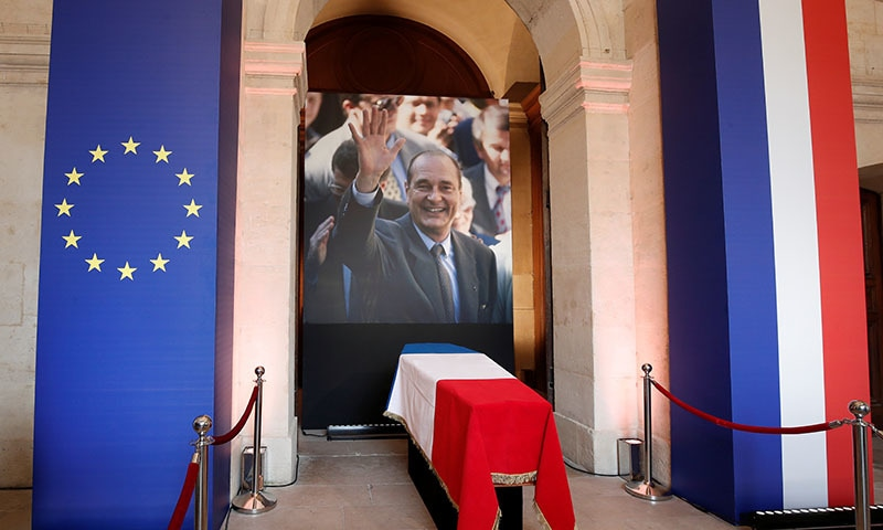 The coffin of late French President Jacques Chirac is seen at the Hotel des Invalides, during a popular national tribute in Paris, France, on September 29. — Reuters