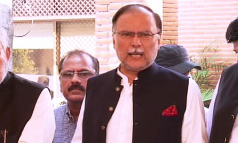PML-N Ahsan Iqbal speaks to reporters in Lahore on Monday. — DawnNewsTV  — DawnNewsTV/File