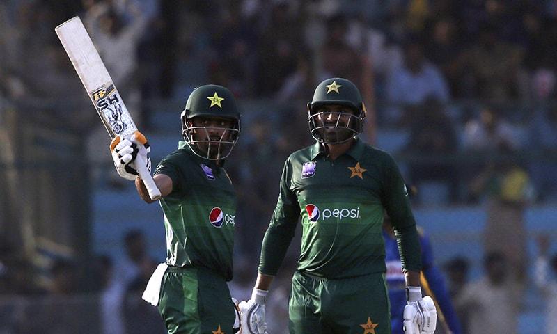 Babar Azam, left, acknowledges his fifty against Sri Lanka with Haris Sohail, in Karachi on Monday, Sept. 30. —  AP