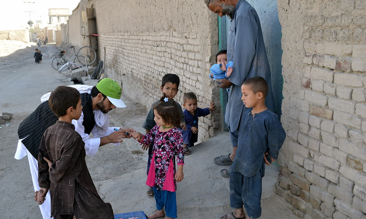 Polio vaccinator marking the finger of the children's after vaccinated him by the polio vaccine. Polio vaccinator Atta Khan said, we have some tribal systems in Chaman, most of the people bring their children's for Polio vaccine but the children's under 6 moths are missed many time, because they are inside the home, the family did not want to bring them outside, and we are not allow to go inside the home. — Matiullah Achakzai