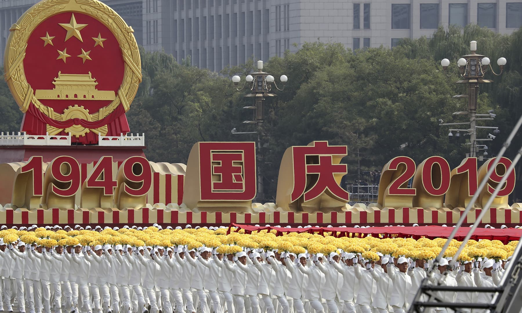 Participants march during the the celebration to commemorate the 70th anniversary of the founding of Communist China in Beijing on Tuesday, October 1, 2019. — AP