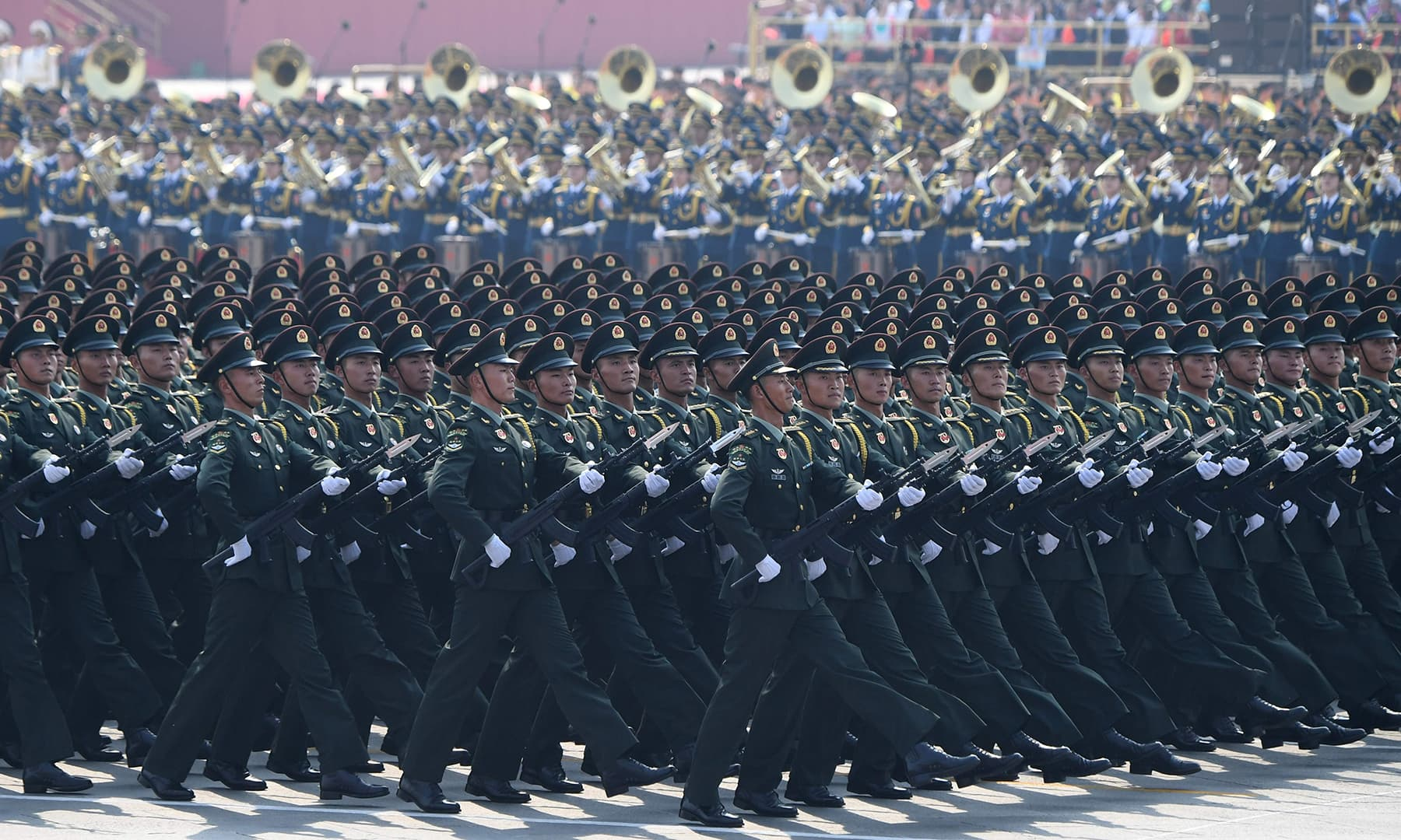Chinese troops march during a military parade in Tiananmen Square in Beijing. — AFP