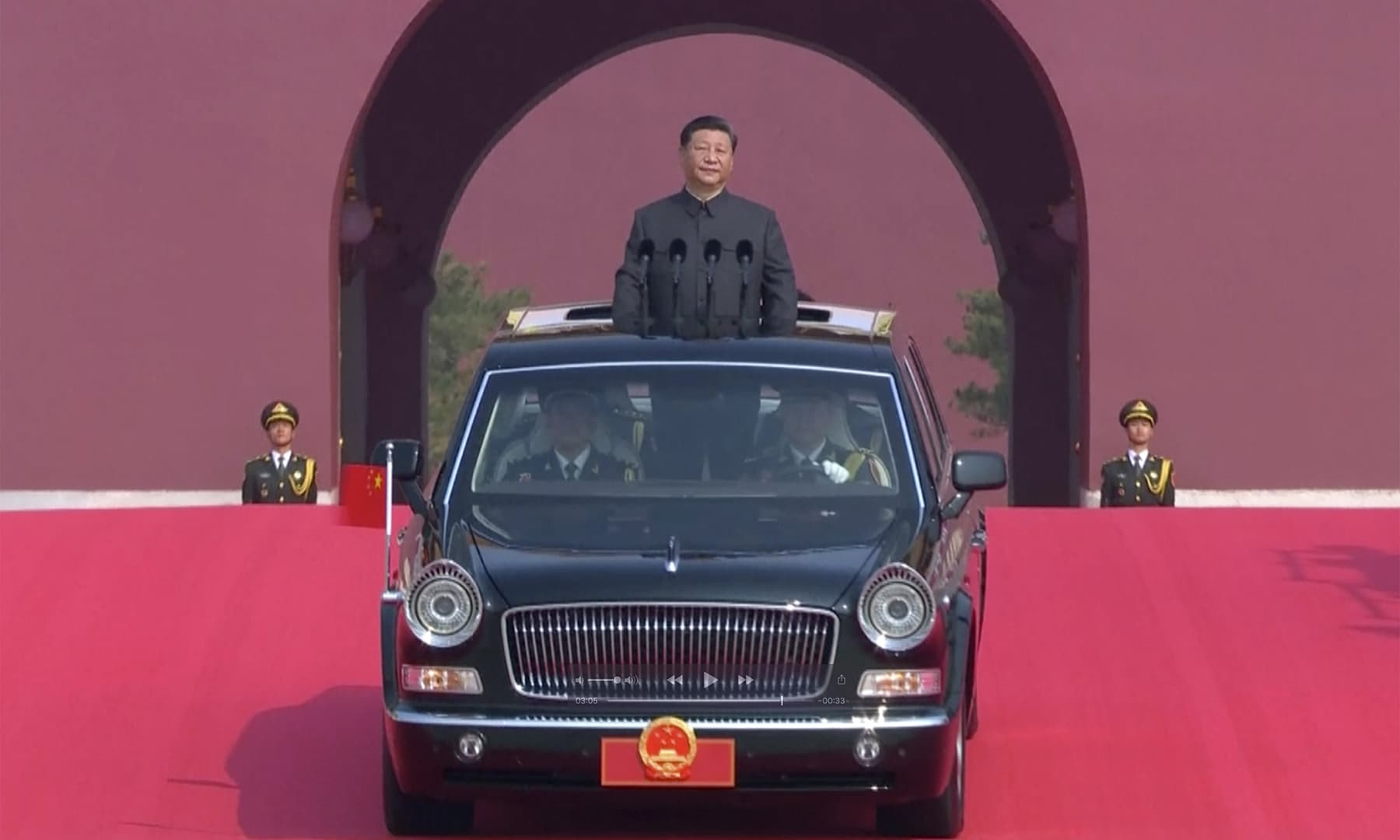 In this image made from video, Chinese leader Xi Jinping rides an open-top limousine during a parade to mark the 70th anniversary of the founding of Communist China, in Beijing. — AP