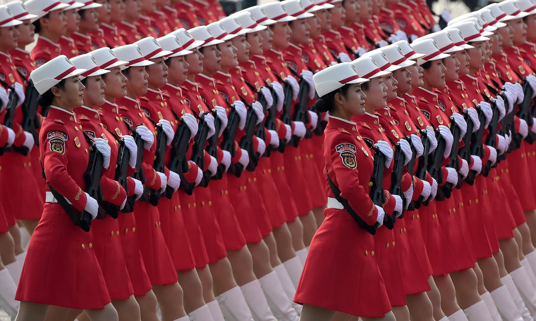 Chinese People's Liberation Army personnel participate in a military parade at Tiananmen Square in Beijing. — AFP