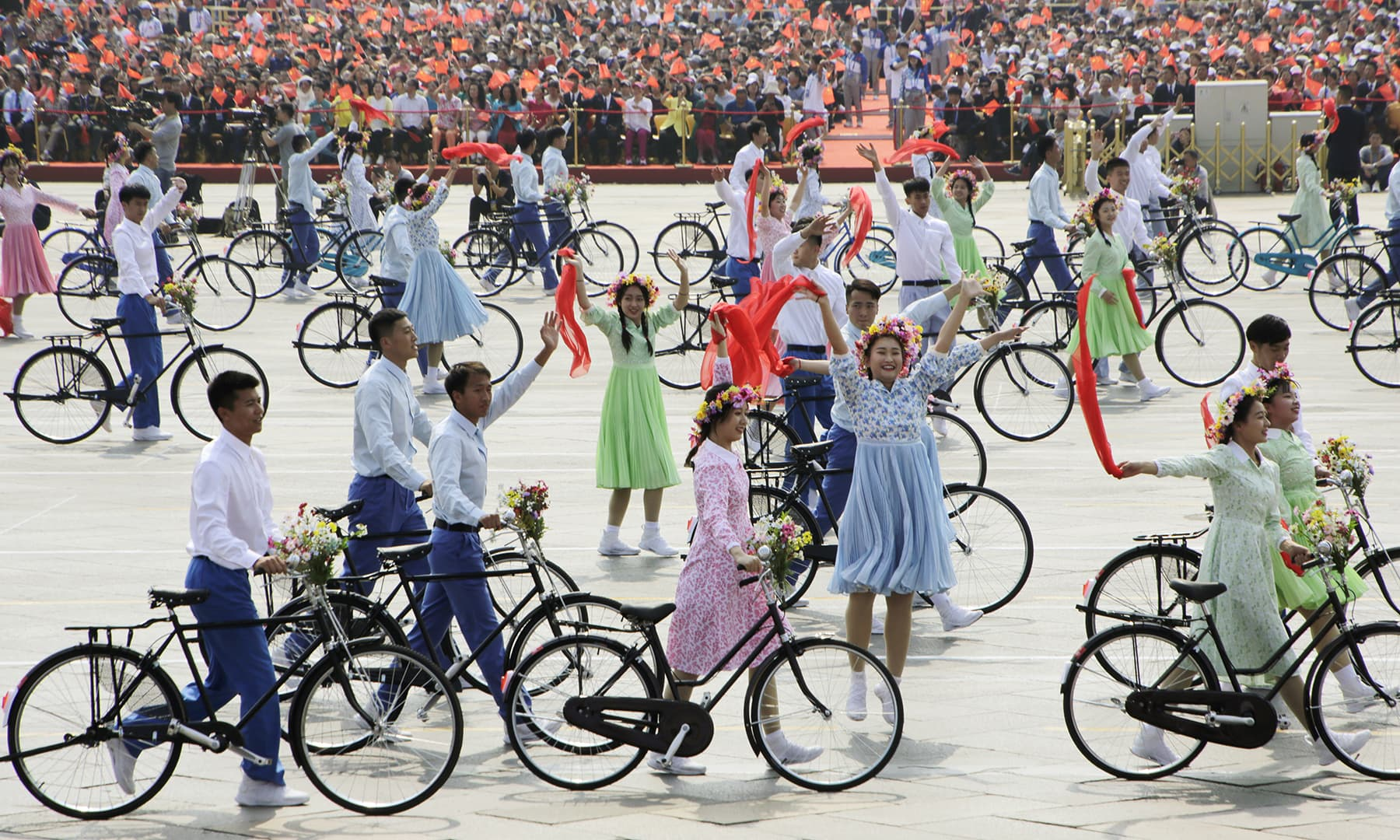 Performers with bicycles take part in the parade marking the 70th founding anniversary of People's Republic of China, on its National Day in Beijing. — Reuters