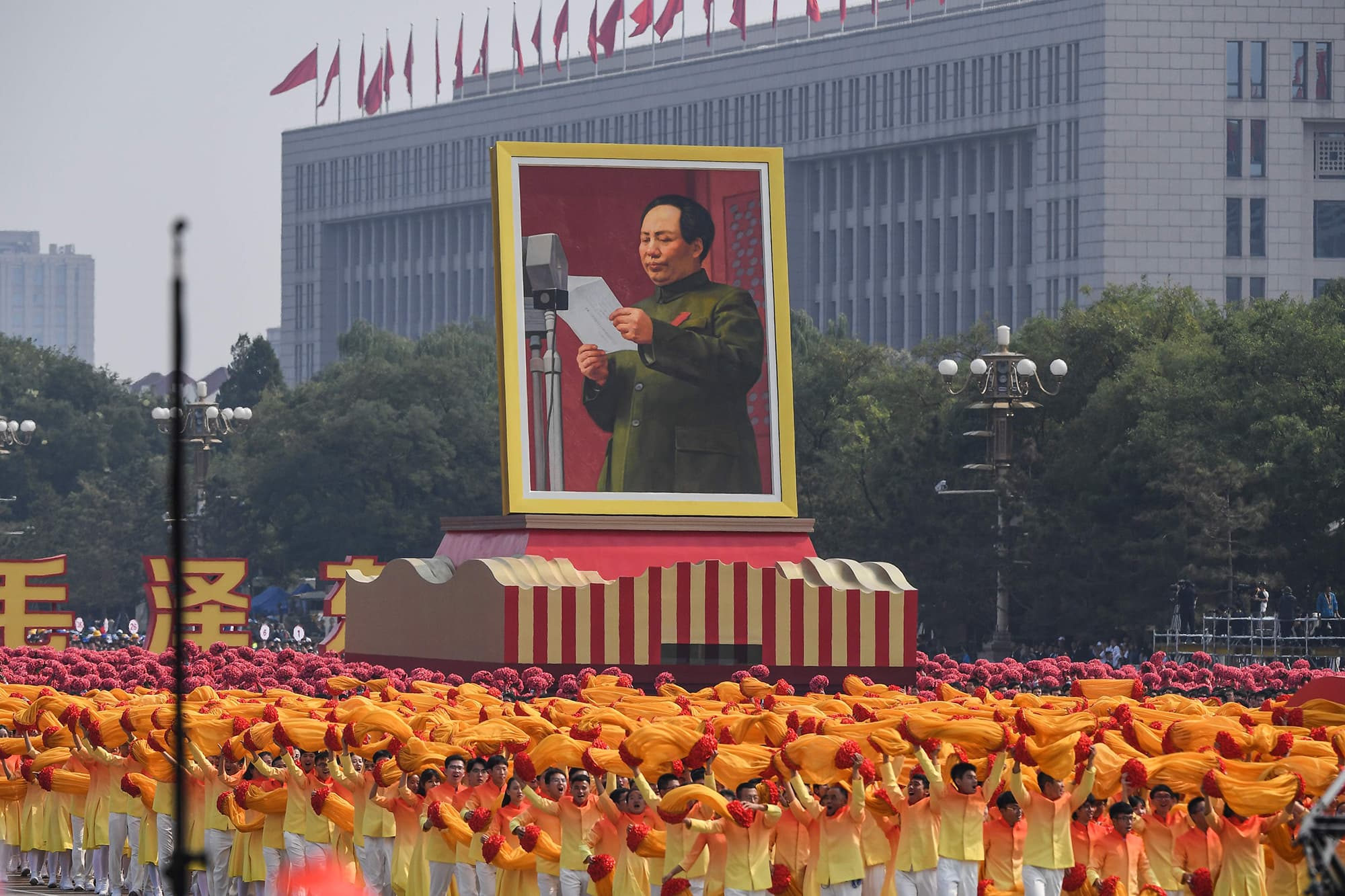 A giant portrait of former Chinese Communist Party leader Mao Zedong passes by Tiananmen Square during the National Day parade in Beijing on October 1, 2019, to mark the 70th anniversary of the founding of the People's Republic of China. (Photo by Greg BAKER / AFP) — AFP or licensors