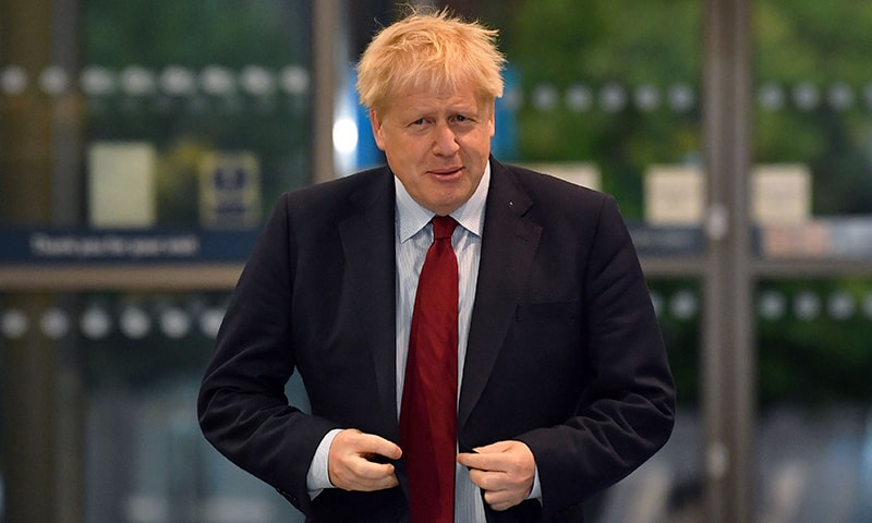 Britain's Prime Minister Boris Johnson arrives at the Manchester Central convention complex to give media interviews ahead of the third day of the annual Conservative Party conference, in Manchester, north-west England on Tuesday. — AFP