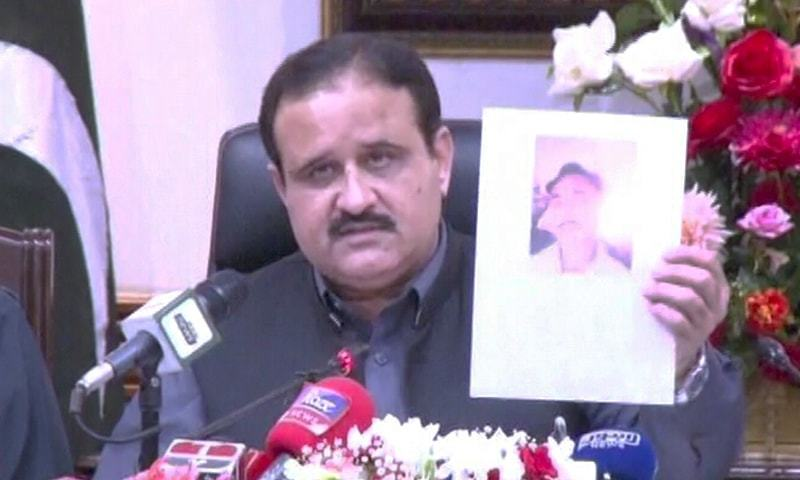 Punjab Chief Minister Usman Buzdar holding up a picture of the suspect during a press conference in Lahore on Tuesday. — DawnNewsTV