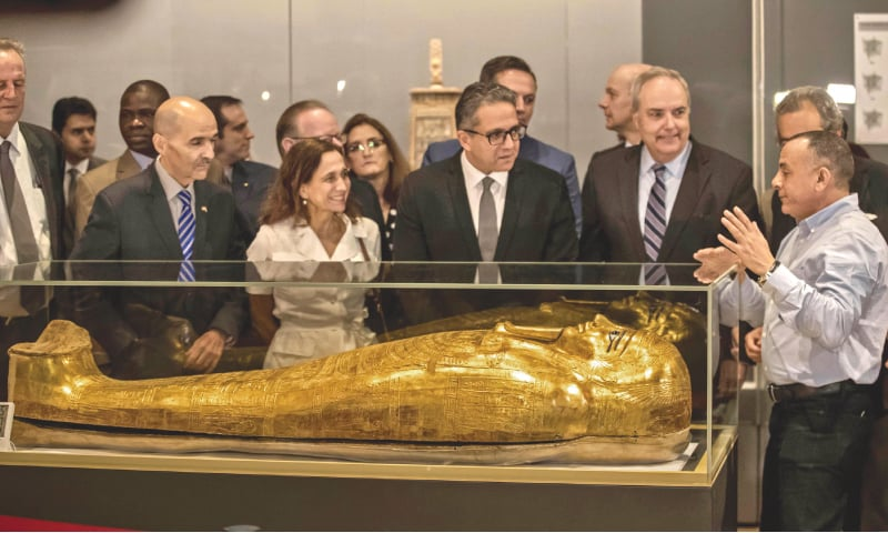 Cairo: Egypt's Antiquities Minister Khaled El-Enany (third right) and Chargé d'Affaires at the US Embassy in Cairo Thomas Goldberger (second right) look at the Golden Coffin of Nedjemankh, on display at the National Museum of Egyptian Civilisation following its repatriation from the US. — AFP