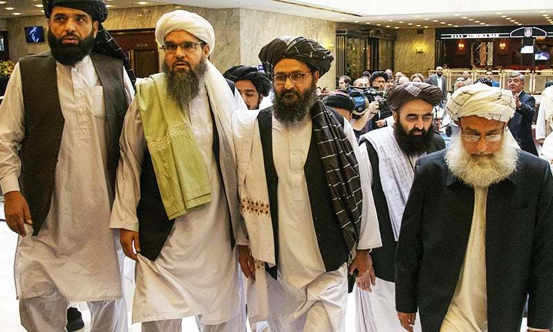 In this May 28 file photo, Mullah Abdul Ghani Baradar, third from left, arrives with other members of the Taliban delegation for talks in Moscow, Russia. — AP