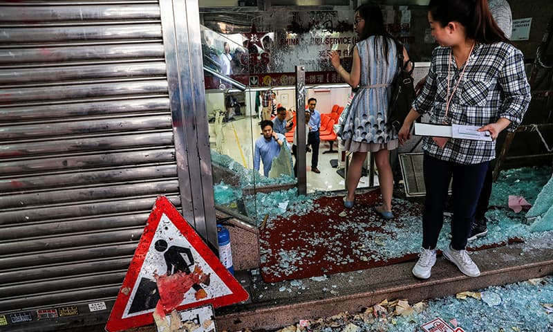 Employees of China Travel Service, a tourism and travel agency of the China government, are seen at their vandalised office in Tsuen Wan, Hong Kong, China on October 2, 2019. — Reuters