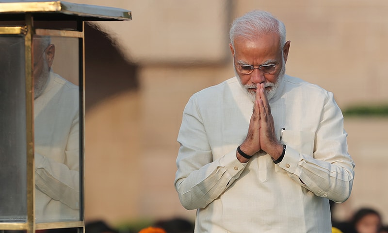 India's Prime Minister Narendra Modi walks after paying homage at the Mahatma Gandhi memorial on the 150th birth anniversary of Gandhi at Rajghat in New Delhi, India on October 2. — Reuters