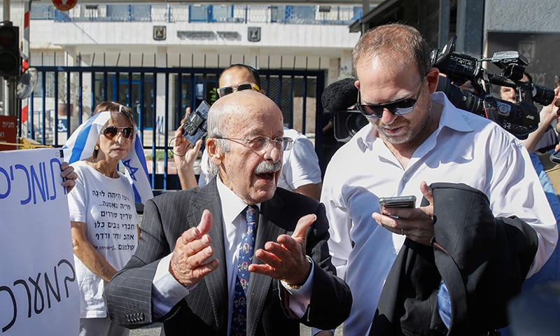 Ram Caspi (L), the prime minister's lawyer, arrives at the Ministry of Justice in Jerusalem on October 2, 2019 ahead of the pre-indictment hearing for Israeli Prime Minister Benjamin Netanyahu. — AFP