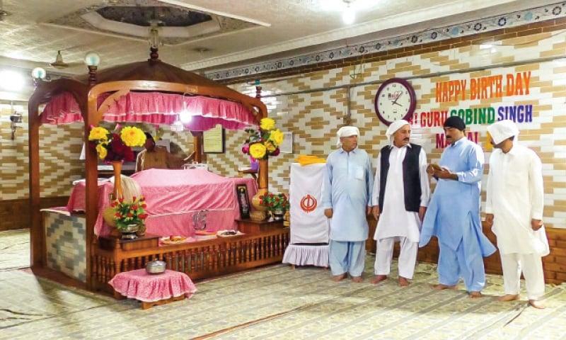 Members of Sikh community worship in a gurdwara in Mingora. — Dawn