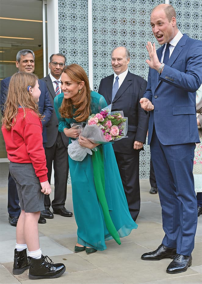 LONDON: Britain's Prince William and Catherine, Duchess of Cambridge, meet a schoolgirl as they visit the Aga Khan Centre on Wednesday. The royals attended an event hosted by Prince Karim Aga Khan, where they engaged with members of the Pakistani community. The Duke and the Duchess of Cambridge are scheduled to pay an official visit to Pakistan from Oct 14 to 18.—Reuters