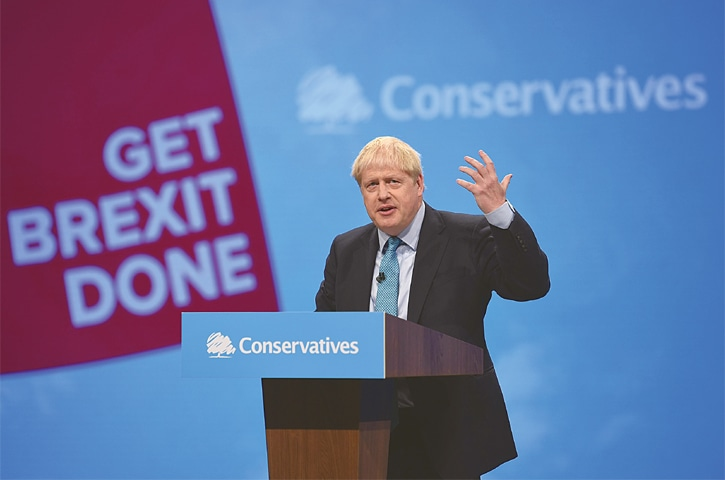 MANCHESTER: Britain's Prime Minister Boris Johnson delivers his keynote speech to delegates on the final day of the Conservative Party's conference on Wednesday.—AFP