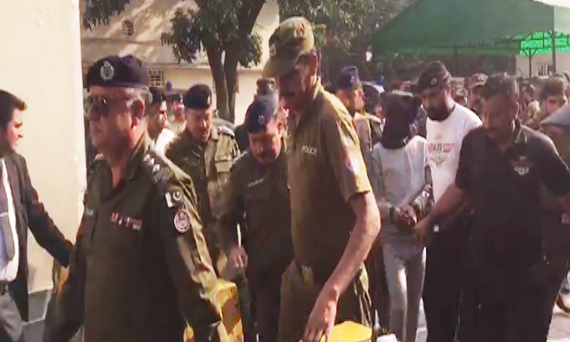 Suspect Sohail Shahzad being brought into the court by police with a black hood over his head on Wednesday. — DawnNewsTV/File