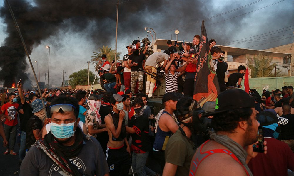 """Death toll surges to 44 as Iraq unrest accelerates; no """"magic solution"""" says PM"""