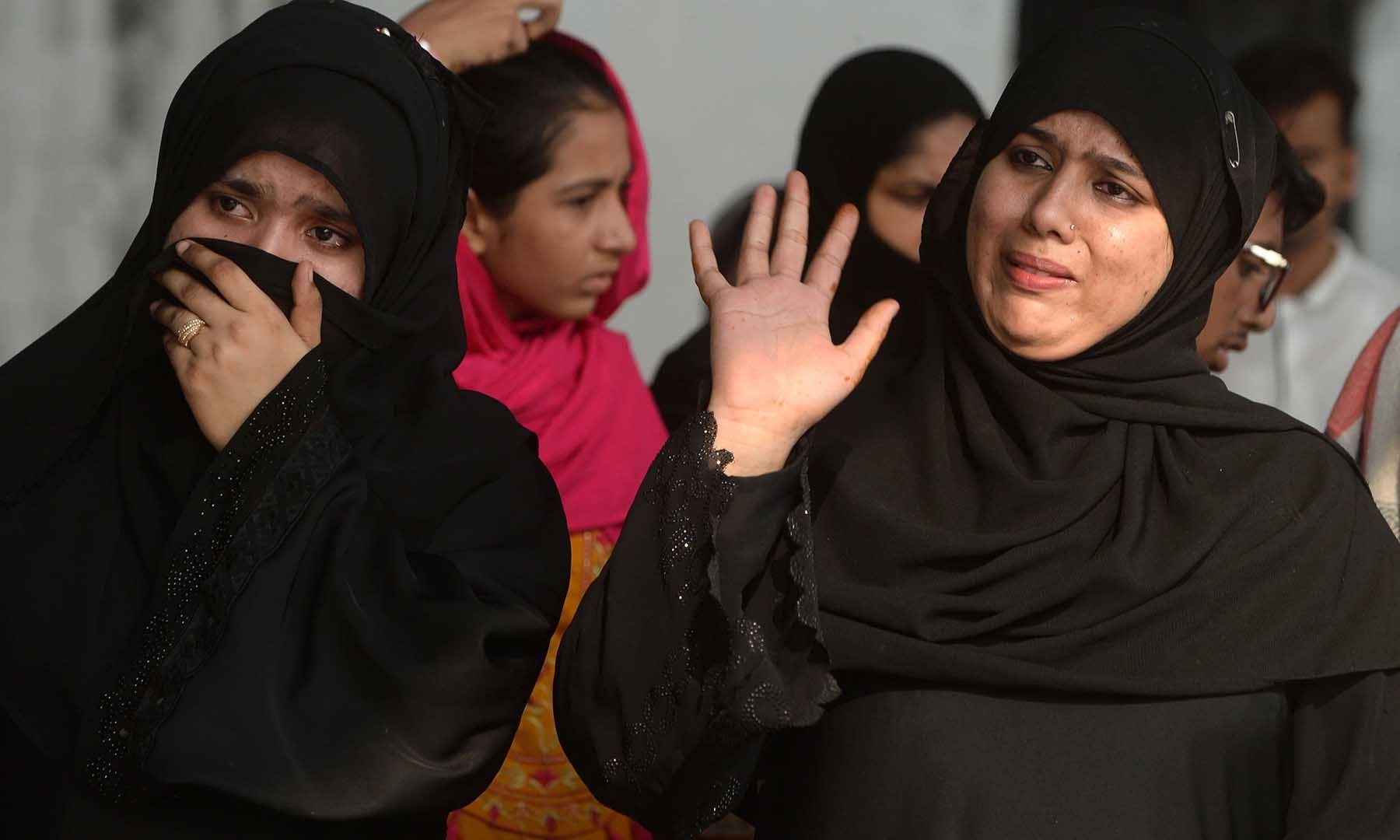 Pakistani women react after the departure of their Indian relatives travelling with the Samjhauta Express train, also called the Friendship Express that runs between Delhi and Attari in India and Lahore in Pakistan, at the railway station in Lahore on Aug 8. — AFP
