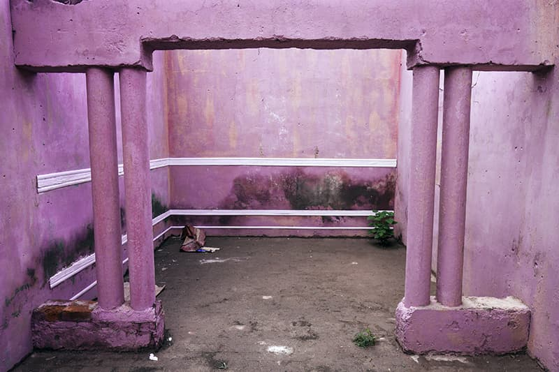 This freshly-painted pink room is one of many small, open-air spaces inside the studio. Soon after the room was painted, a thick covering of algae began to peek through the emulsion.