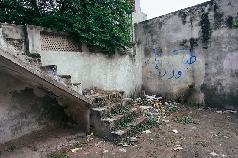 Trash and debris can be seen strewn around in corners of Bari Studios. This crumbling staircase is just one of the reminders of the neglect it has been subjected to.