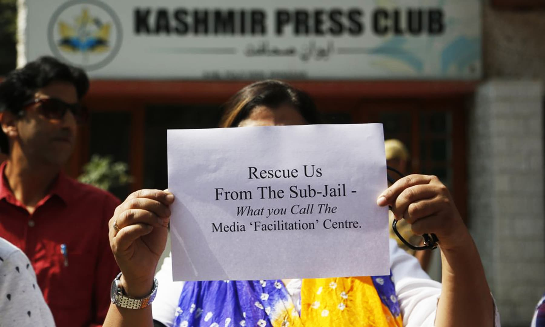 A Kashmiri journalists displays a placard during a protest against the communication blackout in Srinagar, , Thursday. — AP