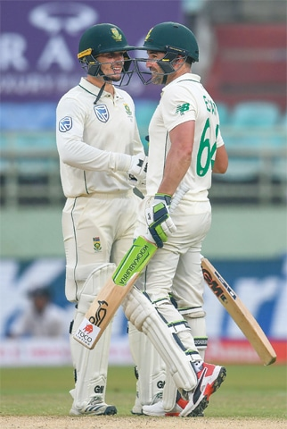 VISAKHAPATNAM: South African openers Quinton de Kock (L) and Dean Elgar celebrate after the latter reached 150 runs during the first Test against India at the Dr. Y.S. Rajasekhara Reddy ACA-VDCA Stadium on Friday.—AFP
