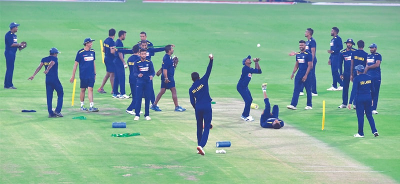 LAHORE: Sri Lankan players take part in a training session at the Gaddafi Stadium on Friday.—M.Arif/White Star