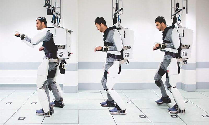 Combination of photographs shows Thibault as he stands while wearing an exoskeleton.—AFP