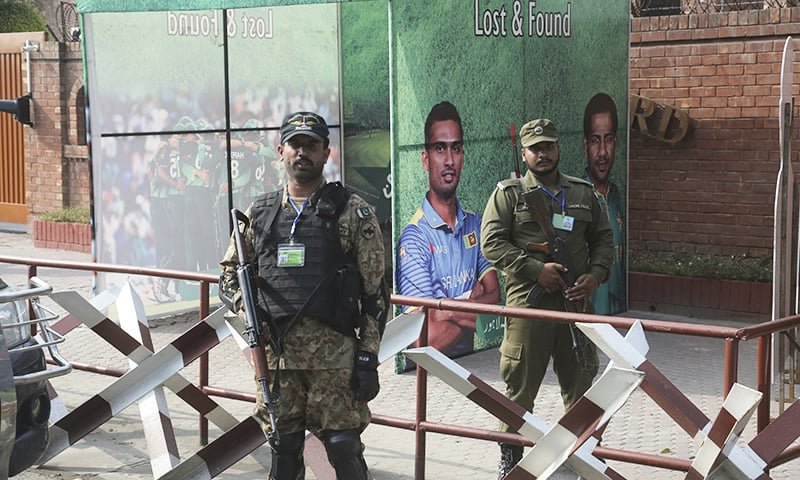 Pakistani soldier and police officer stand guard outside the Gaddafi stadium ahead of Pakistan-Sri Lanka cricket match in Lahore on Friday, October 4, 2019. — AP
