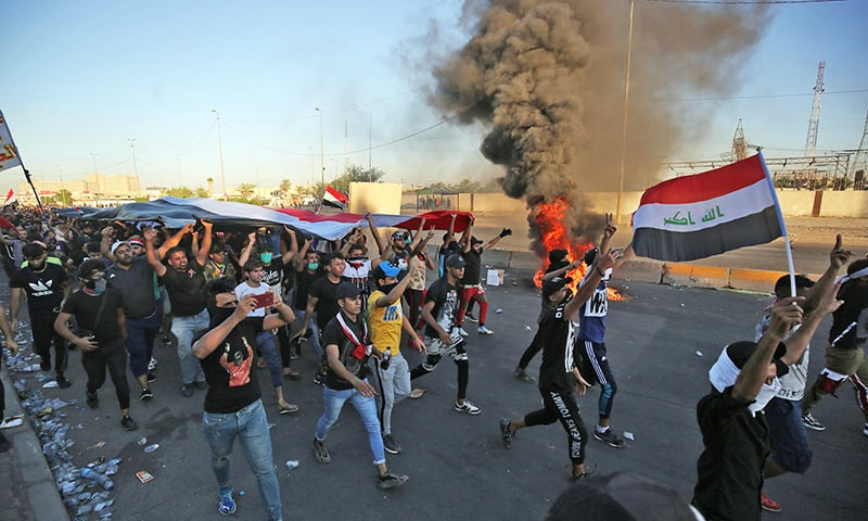 Protesters flood Iraq streets anew as death toll nears 100