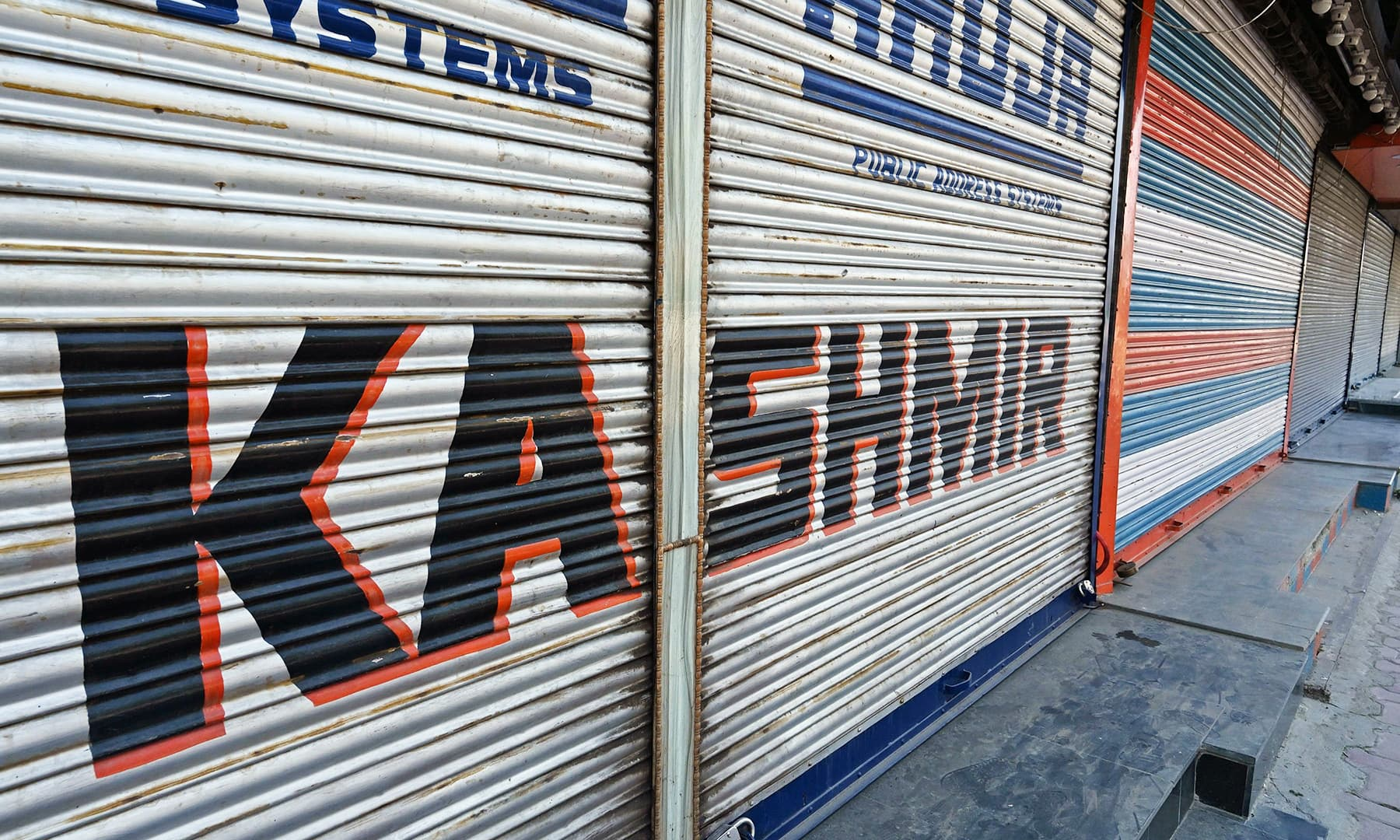 This file photo taken on September 8,  shows closed shops in Srinagar. — AFP