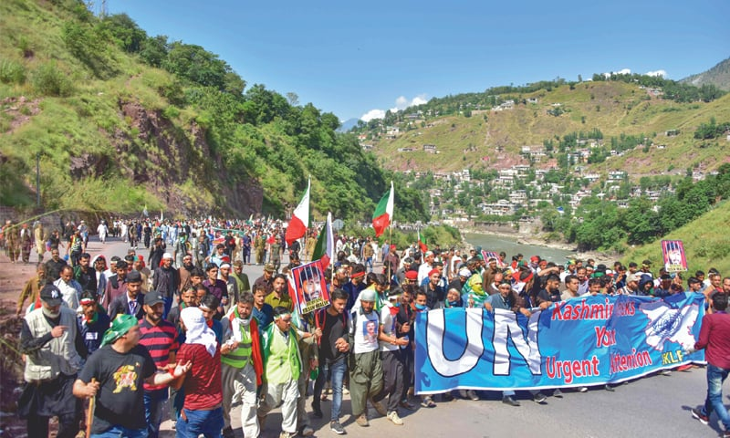 Muzaffarabad: Kashmiri people march towards the town of Chakothi on Saturday to protest against the Indian government lockdown of held Kashmir.—AFP