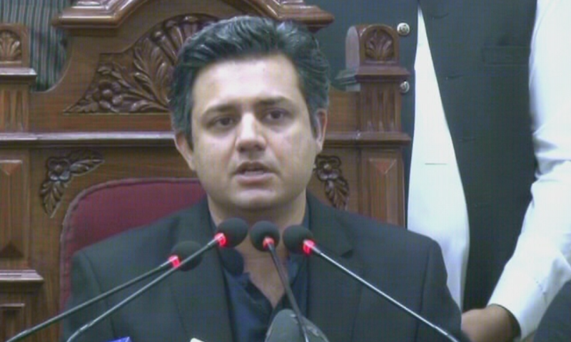 Federal Minister for Economic Affairs Hammad Azhar addressing a press conference in Lahore on Sunday. — DawnNewsTV