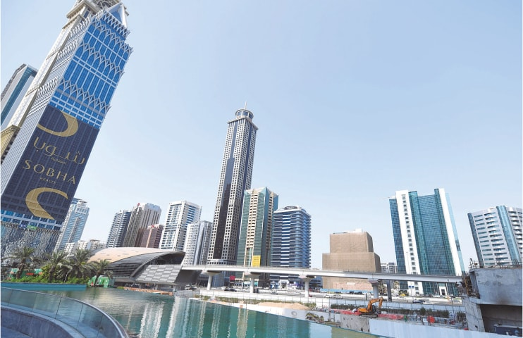 This picture shows buildings on Sheikh Zayed road last week in Dubai. With the highest tower in the world, grand commercial centres and artificial islands, Dubai projects an image of prosperity, even as the city-state races to court investors to bolster a flagging economy. Despite boasting the most diverse economy in the Gulf region, the emirate's vital property, tourism and trade sectors have weakened in recent years.—AFP
