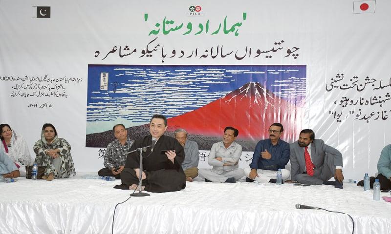 Deputy Consul General of Japan Katsunori Ashida presents his haikus at the mushaira. —Faysal Mujeeb / White Star