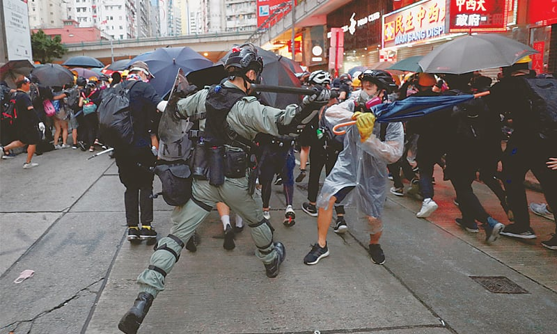 Chaos hits Hong Kong again as thousands defy mask ban