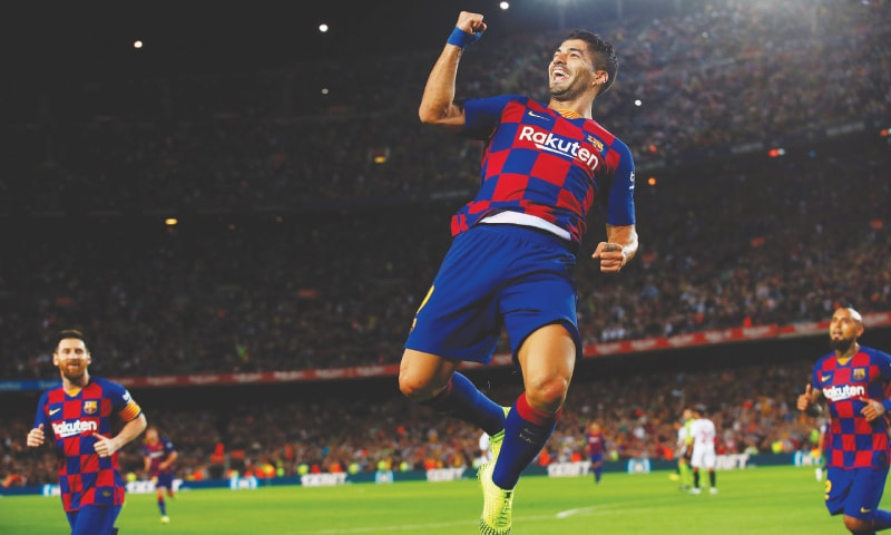BARCELONA: Barcelona's Luis Suarez celebrates after scoring during the La Liga match against Sevilla at Camp Nou.—Reuters
