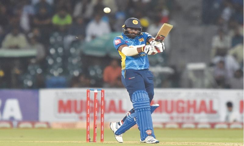 SRI LANKAN batsman Bhanuka Rajapaksa hits out during his 77-run knock in the second Twenty20 International against Pakistan at the Gaddafi Stadium on Monday.—M.Arif/White Star