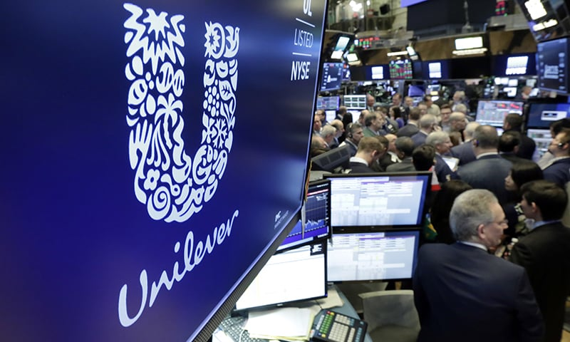 In this March 15, 2018 file photo, the logo for Unilever appears above a trading post on the floor of the New York Stock Exchange. — AP