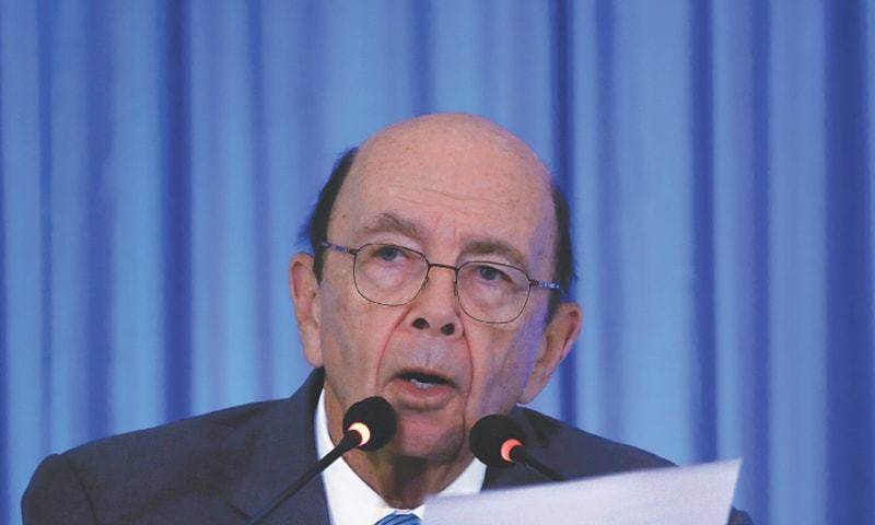 "The United States ""cannot and will not tolerate the brutal suppression of ethnic minorities within China,"" Secretary of Commerce Wilbur Ross said, announcing the move, which bars the named entities from purchasing US products. — Reuters/File"