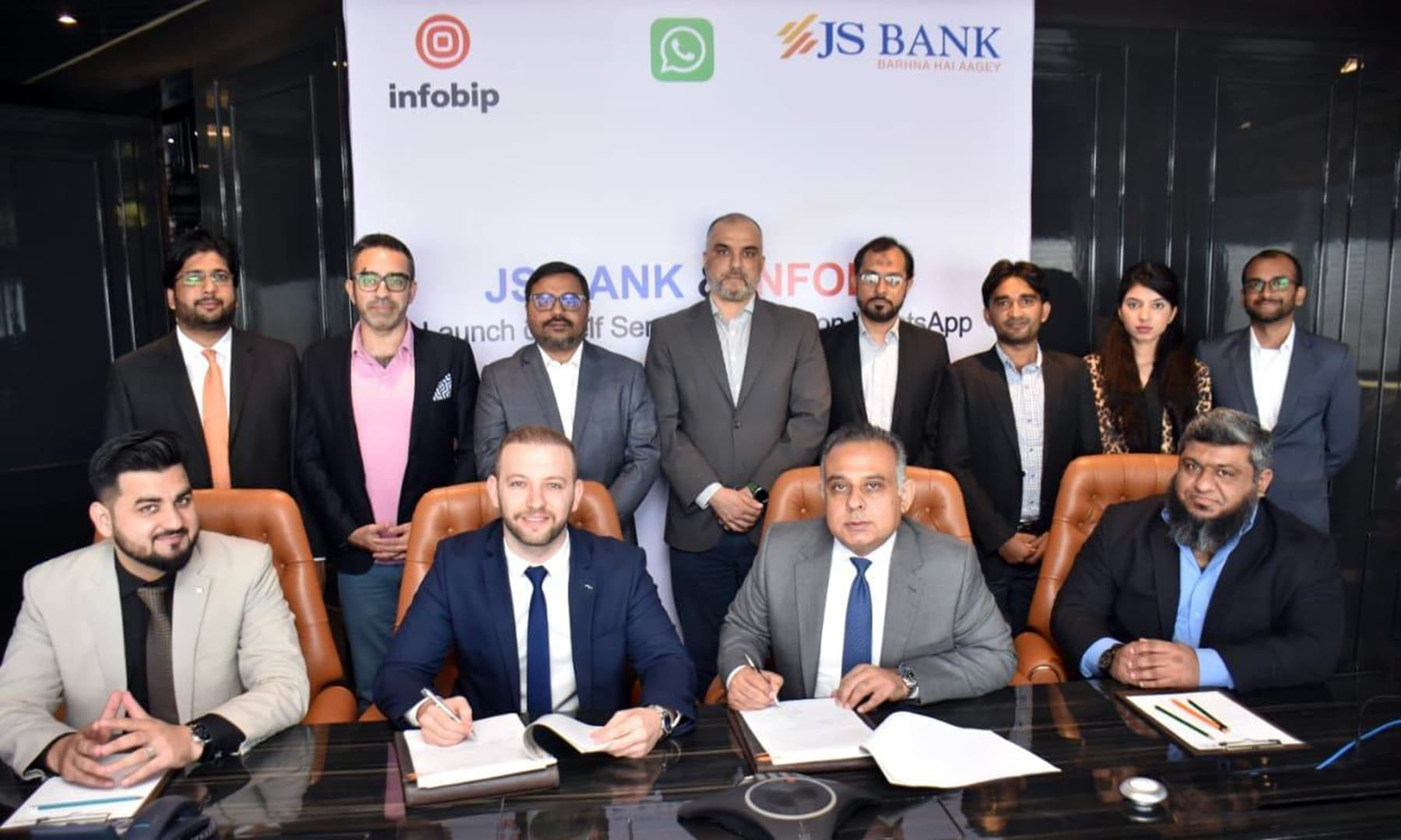 President and CEO JS Bank Basir Shamsie and Company Secretary Infobip Guray Ozturk sign agreement to Launch 'Self-Service Banking on WhatsApp. — JS Bank