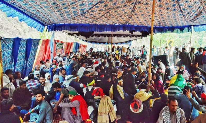A view of activists sitting under a tent near Jiskool on Tuesday. JKLF-led marchers are on a sit-in at this spot since Sunday when their march towards the LoC was greeted by obstacles that blocked its movement. — Photo by Tariq Naqash
