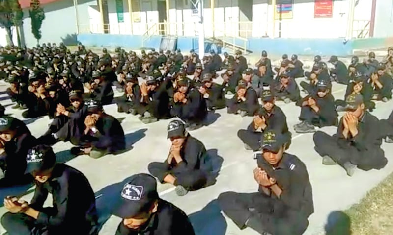 Students of government high school Balakot pray for the departed souls of 80 students, who were killed in 2005 earthquake. — Dawn